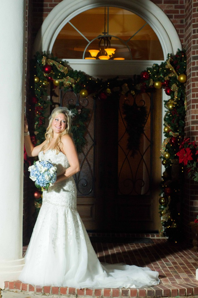 photograph of Bride by standing at a pillar