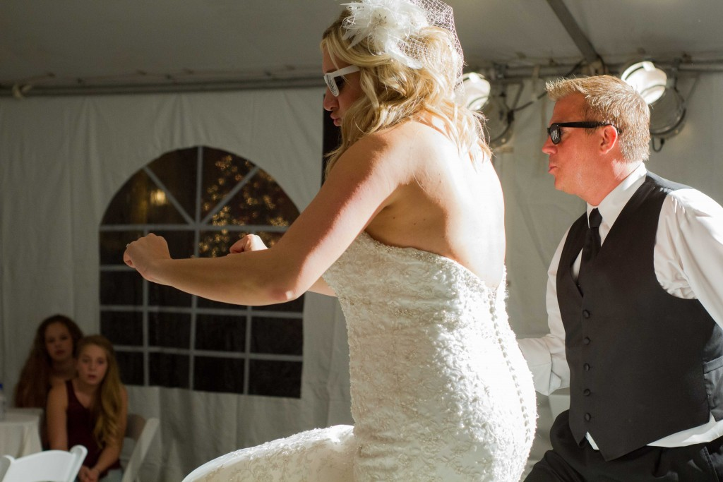 photo of bride and groom dancing at wedding reception