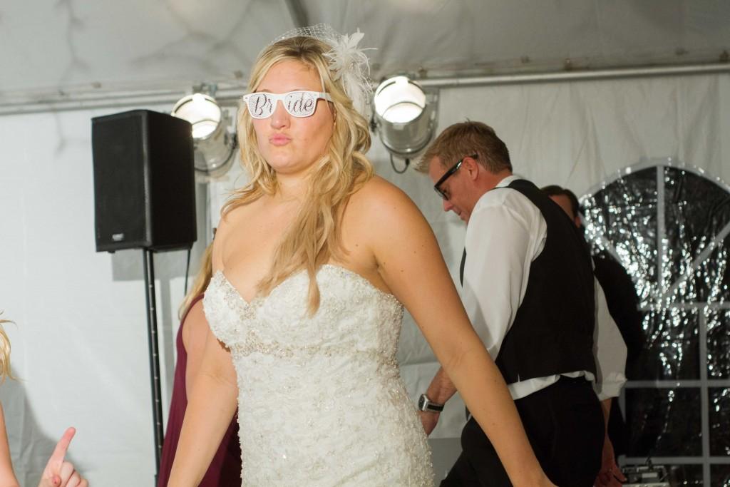 photo of bride wearing sunglasses at wedding reception
