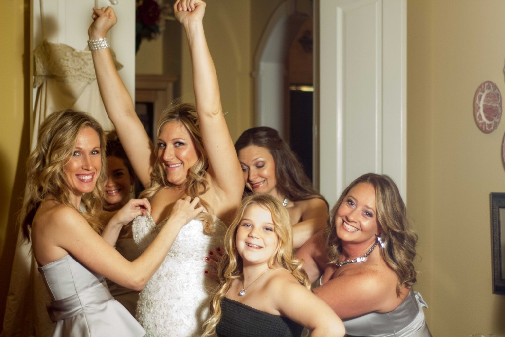 photograph of Bride getting ready with bridesmaids